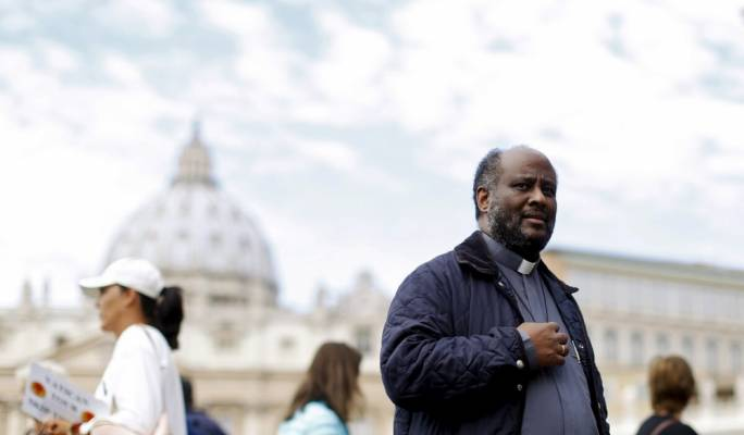Priest who saves migrants' lives when he calls Malta RCC is hauled to Trapani court
